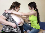Fat old nanny is satisfied by sweet looking brunette wearing strapon
