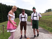 Cute pigtailed blondie Nikki Dream is having threesome sex in the meadow