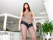 Trashy looking slut in fishnet stockings Lydia Lust takes part in gangbang scene