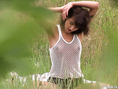 Cute teen Suzy Rainbow is toying her fresh looking pussy in a meadow