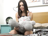 Tempting teen Lou is playing with her charming plump pussy