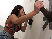Slut Britney Amber enjoys sucking balck dick in the glory hole room