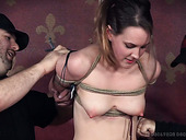 Nasty gal Sierra Cirque is tied up and spanked by several guys