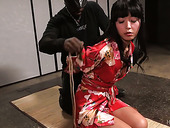 Asian hottie Marica Hase is tied up and suspended in the torture room