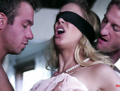 Two dudes fuck blind folded bitch Cherie Deville and make her twat cum