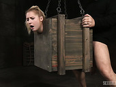 Blond slut Odette Delacroix is restrained in a wooden chest