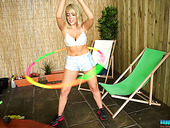 Full natural busty blonde shakes her tits and twists the hoop