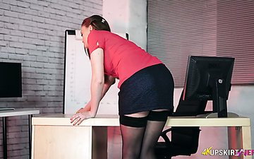 Young secretary Honour May shows her yummy pussy spreading legs wide open
