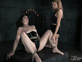 Mistress punishes twat of one tied up hoochie in the dark room