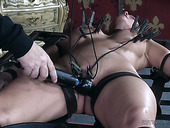 Big tittied brunette in the cage Syren De Mer is punished by one perverted dude