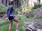 Pretty hot teen Nessy is masturbating deep in the forest