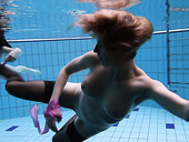 Beautiful hottie Andrejka and her assistant undress under the water