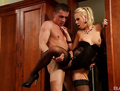 Graceful babe in sexy black lingerie Kelly swallows cock before riding scene