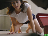 Pretty hot teen Karlie Brooks gives her head to a mechanic lying under the car