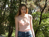 Young hottie Milena Devi touches her tits and dildo fucks pussy in the park