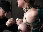 Kinky perverted dude conducts experiments on tied up busty bitch Dee Williams