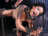 Black porn model Skin Diamond gets punished in the dark bdsm room