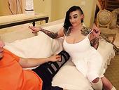 Sassy tattooed whore Scarlet Lavey is fucked by one kinky dude