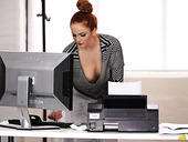 Red haired secretary Kara Carter shows her big boobies popping out of blouse
