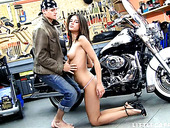 Biker fucks pretty hot babe Caprice outdoor right on the ground