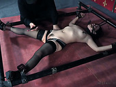 Young brunette Yhivi is restrained and punished in the torture room