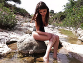 Posh young model Milla is stripping and masturbating pussy outdoor