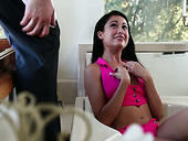 Cute teen Lilly Evans tries to butter up one angry dude and shows him her nice tits
