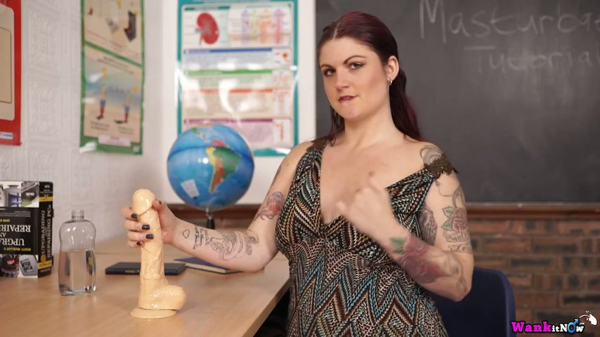Attractive busty teacher Miss Selene shows off her full natural boobies