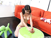Cute young pigtailed chick Little Caprice is playing with her pussy on the couch