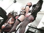 Voluptuous dominatrix wearing strpon punishes Alissa Noir and her assistant