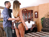 Cuckold husband is looking at his whore wife sucking two big black dongs