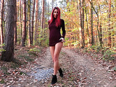 Red haired seductress Paula Shy takes off her clothes in the forest