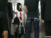 Whorish Japanese college chick Yayoi Yoshino is fucked by several dudes in the subway car