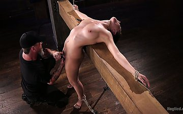 Tied up and crucified babe Roxanne Rae is punished with long stick with dildo tip