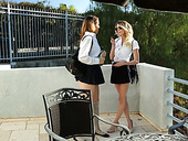 Yummy babe Shauna Skye pleases pussy of naughty college mate in the kitchen