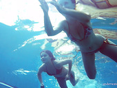 Underwater strip tease by naughty babe Marusia and her pretty girlfriend