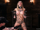 Tied up and restrained tattooed bitch Kleio Valentien gets punished