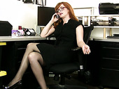Red haired bookkeeper Amber Dawn is playing with closeup pussy