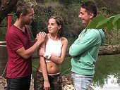 Full natural busty teen Anabelle is fucked by two strangers by the river