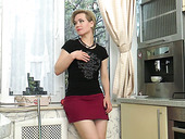 Young housewife Lisa Young is playing with her alluring pussy in the kitchen