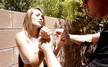 Arrested chick Kirsten Lee gives a blowjob to one dude in police uniform