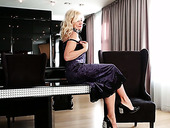 Blond cougar Sylvie is playing with her stretched shaved pussy