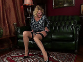 Cougar in sexy lingerie Molly Maracas is masturbating her yummy twat