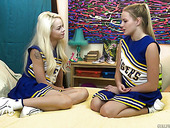 Two lovely cheerleaders enjoys licking each others yummy pussies