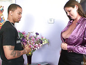 Black delivery dude has the honor of fucking mega busty milf Carrie Moon