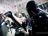 Suspended upside down bitch Odette Delacroix gives a blowjob to one dude in latex outfit