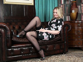 Lecherous mature blonde Emma Turner is playing with her sex-starved snatch