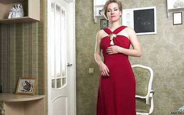 Delicious milf in red dress Lisa Young gets naked and masturbates twat