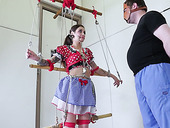 Puppet in polka dot dress allows to penetrate her tight anus and bottomless throat