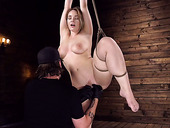 Tied up and suspended hottie Hadley Viscara squirts in the dark BDSM room